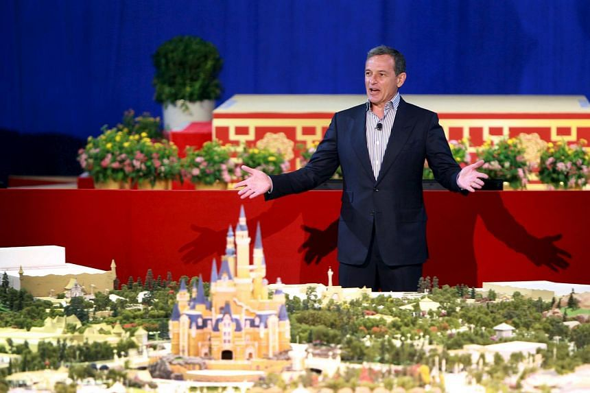 Chairman and CEO of The Walt Disney Company Bob Iger speaks in front of the unveiled scale model of the future Shanghai Disneyland during a news conference, in Shanghai on July 15, 2015.