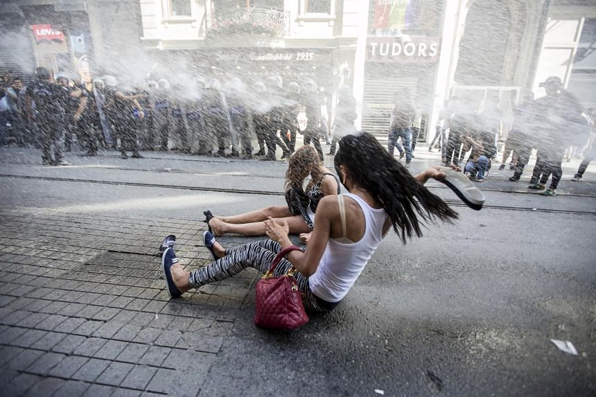 Riot police use a water cannon to disperse activists at a gay pride parade in Istanbul, Turkey.