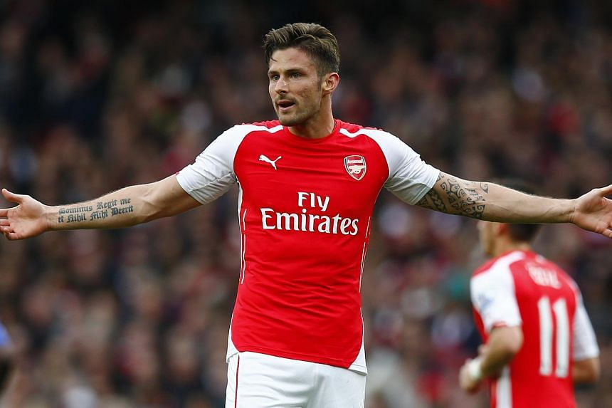 Arsenal's Olivier Giroud reacts during the English Premier League match between Arsenal and Chelsea.