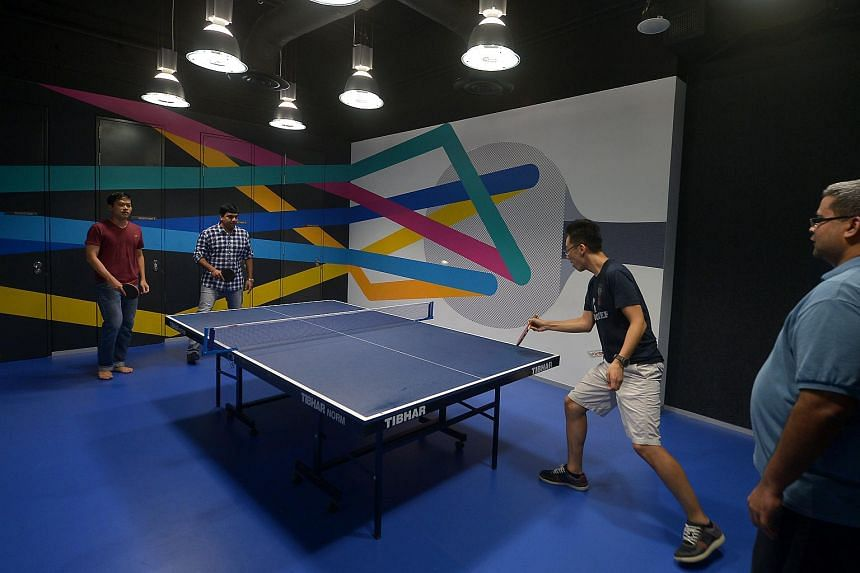 Recreational spaces litter Google Singapore's office, such as one with a ping-pong table for Googlers to unwind with colleagues.