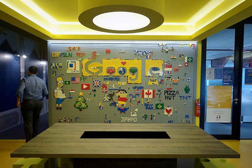 A wall decorated by Googlers at one of their microkitchen pantries.