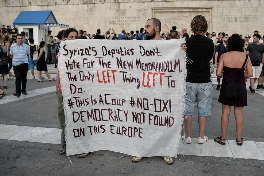 Leftists protesters hold a banner in front of the Greek parliament in Athens, during an anti-EU demonstration calling for a 'No' to any agreement with the creditors.