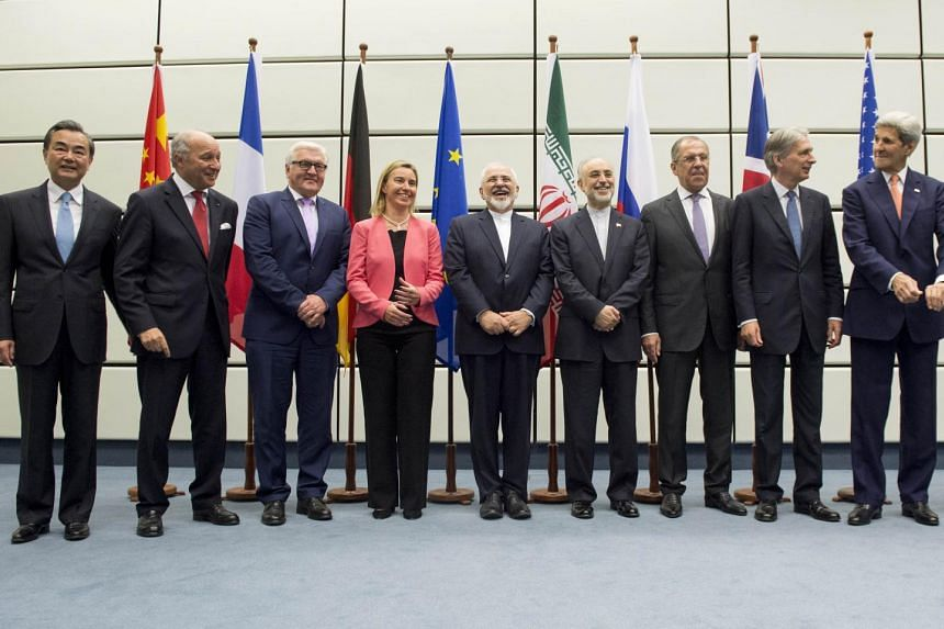 Leaders involved in the talks pose for a group picture at the United Nations building in Vienna.