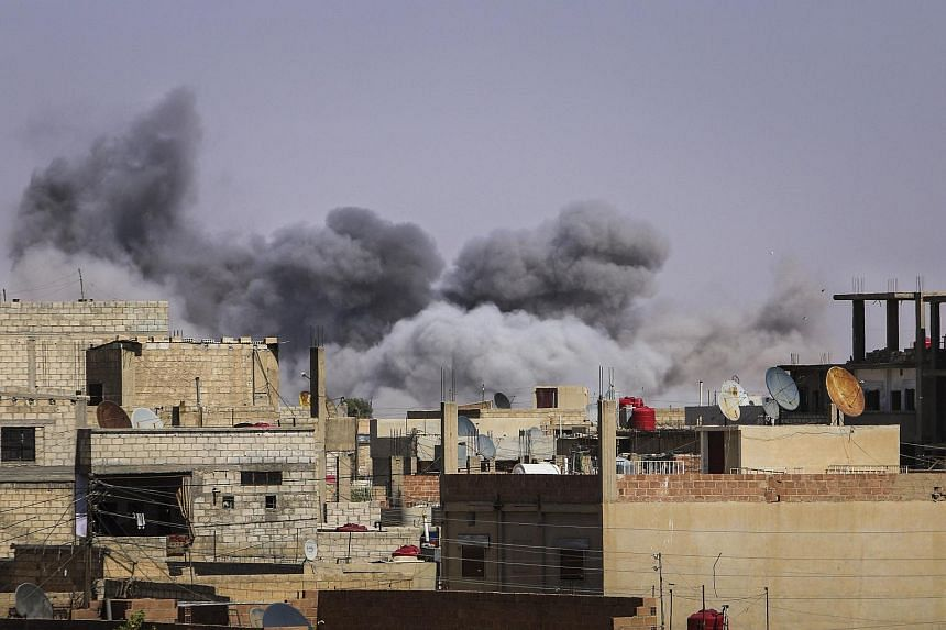 Smoke rises from what activists said were air strikes by forces loyal to Syria's President Bashar al-Assad on locations controlled by Islamic State militants in Hasaka city, Syria, on July 9, 2015.