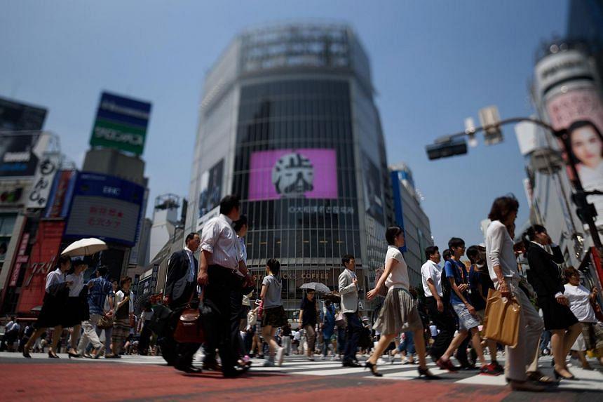 Pedestrians in Tokyo's Shibuya district.