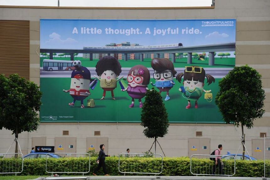 A billboard displaying the Land Transport Authority's five graciousness characters.