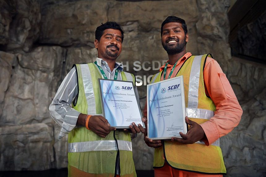 Ponnan Muthukumar (right) and Subramanian Shanmuganathan, foreign workers from India who fearlessly scaled an HDB block to save a trapped toddler.