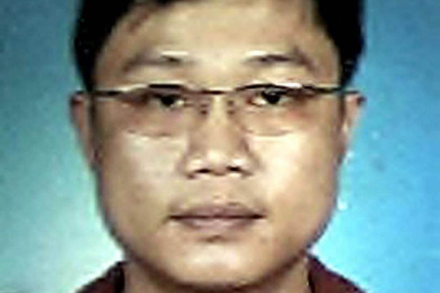 """Ho Yue Keong is accused of harbouring former triad leader Tan Chor Jin, dubbed """"One-eyed dragon""""."""