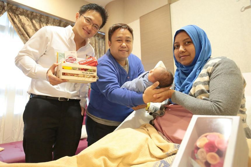 NTUC Youth Development Unit Director and soon-to-be father, Mr Desmond Choo, distributing New Dad's Survival Kits to new fathers in KKH.