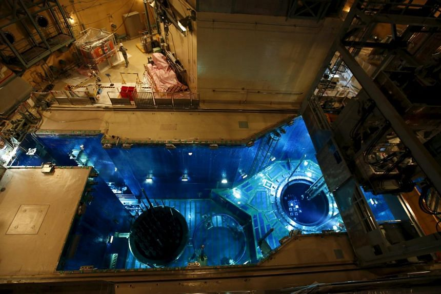 A fuel rod is inserted into a reactor vessel (right) inside the No. 1 reactor building at Kyushu Electric Power's Sendai nuclear power station in Satsumasendai, Kagoshima prefecture, Japan, on July 8, 2015.