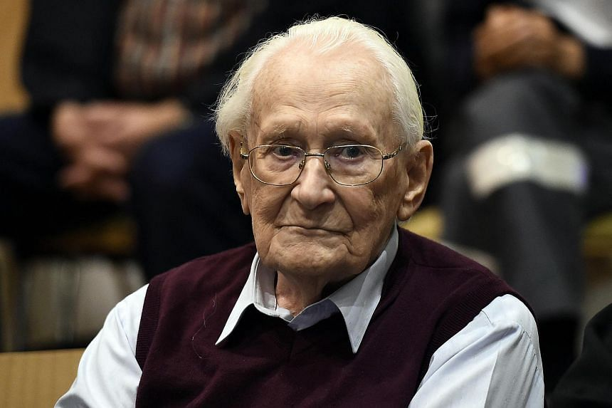 """Oskar Groening, defendant and former Nazi SS officer dubbed the """"Bookkeeper of Auschwitz"""", sits in the courtroom during his trial in Lueneburg, Germany on July 15, 2015."""