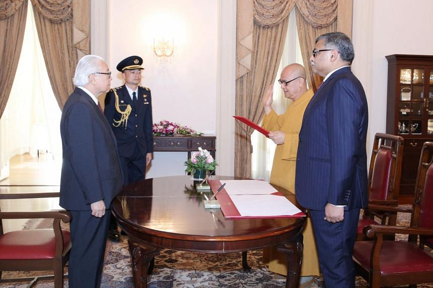 Venerable Sik Kwang Sheng (second from left) taking his oath before President Tony Tan Keng Yam and Chief Justice Sundaresh Menon, who is the chairman of the Presidential Council for Minority Rights.