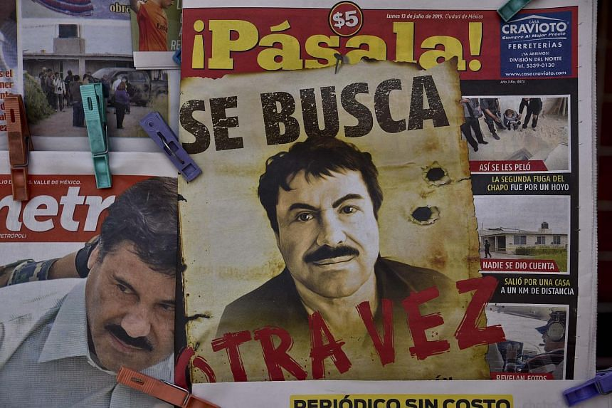 """A poster with the face of Mexican drug lord Joaquin """"El Chapo"""" Guzman, reading """"Wanted, Again"""", is displayed at a newsstand in one of Mexico City's major bus terminals."""