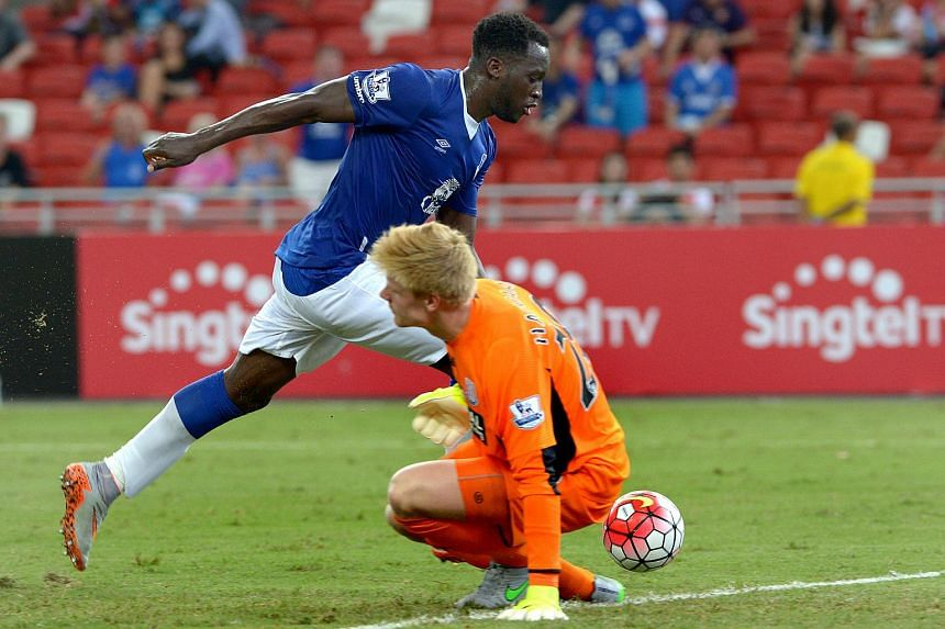 Everton's Romelu Lukaku beats Stoke goalkeeper Jakob Haugaard but his goal was disallowed after the referee signalled an offside at the National Stadium in Singapore on July 15, 2015.