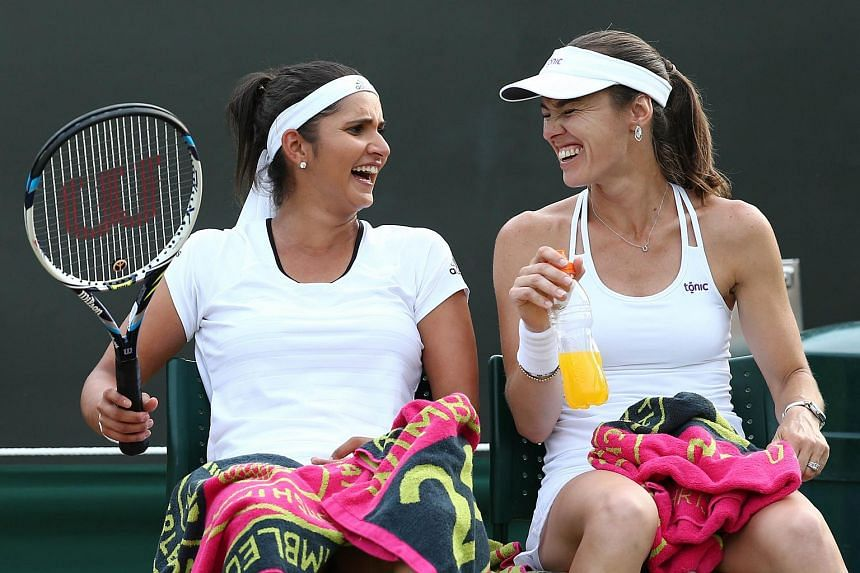 India's Sania Mirza (left) and Switzerland's Martina Hingis have qualified for the BNP Paribas WTA Finals Singapore, after claiming the women's doubles crown at Wimbledon.