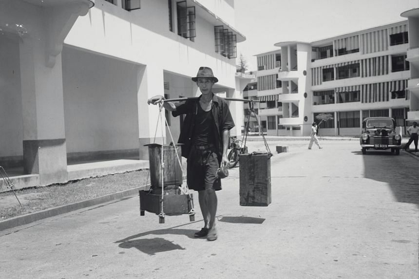A street hawker peddling his wares at the Singapore Improvement Trust flats in Tiong Bahru on Sept 12, 1961.
