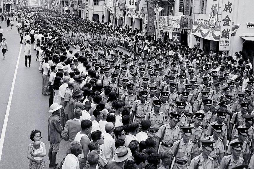 A sense of identity was forming by the first anniversary, as thousands took part in the first National Day Parade on Aug 9, 1966.