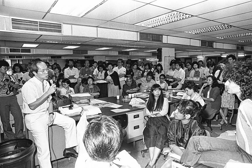 (Left) Mr Peter Lim speaking to journalists in Times House in July 1984, announcing the proposed merger of The Straits Times Press, Singapore News and Publication Ltd and Times Publishing Berhad.