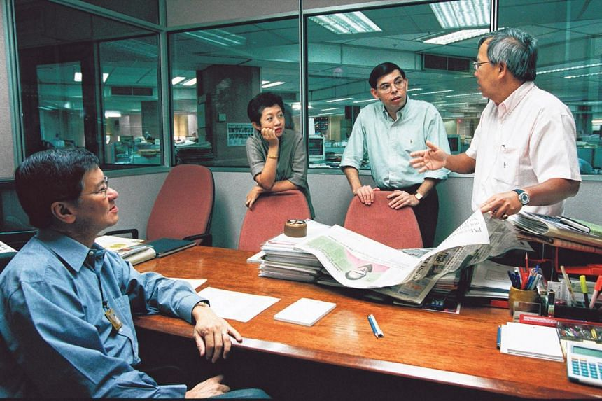 (From right) Mr Leslie Fong holding a story conference with news editor Warren Fernandez, TV news editor Jennifer Lewis and associate editor Bob Ng in October 2000. Mr Fong was appointed editor of The Straits Times in 1987 at age 37.