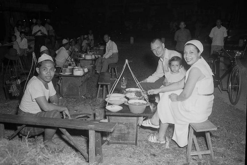 Customers at the Satay Club, which reopened in Dhoby Ghaut Green in 1952.