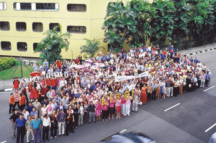 Times House staff gather for a group photo before bulldozers move in.