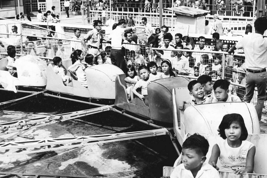 Children enjoying themselves on a ride at the Great World Amusement Park in 1967. There were two other parks: New World and Gay World.