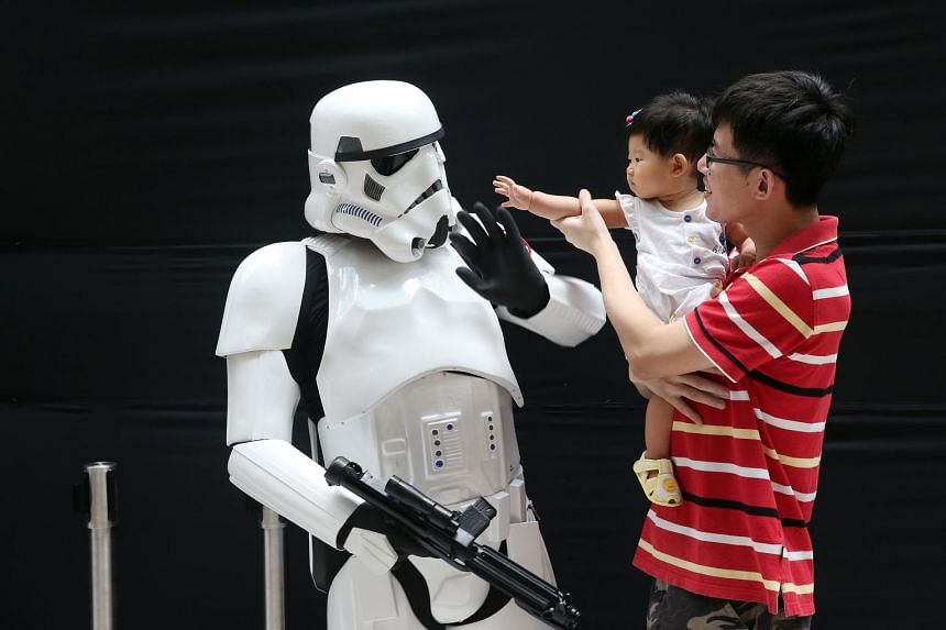 "Eight-month-old Huang Zhen Ling, although too young to be a fan, seemed to be saying ""May the Force be with you"", as she reached out to touch a stormtrooper at an event to celebrate the space movie in May this year."