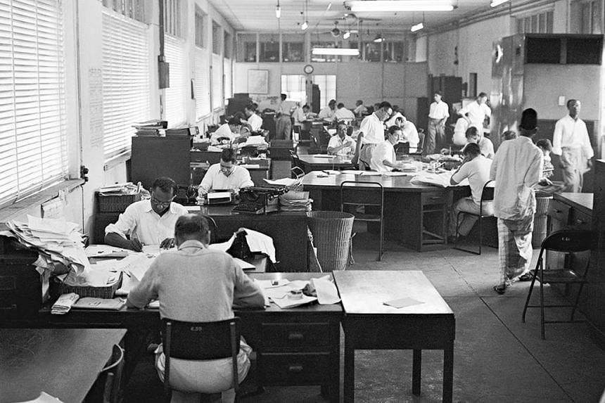The typing pool of The Straits Times' editorial department in 1955 and other employees at work in a large open-plan area (above).