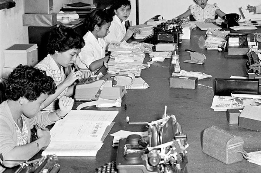 The typing pool of The Straits Times' editorial department (above) in 1955 and other employees at work in a large open-plan area.