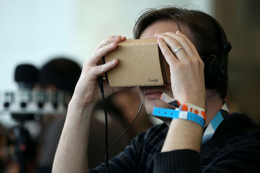 Google Cardboard's headset works with a number of smartphones. It has been improved since it made its debut at last year's Google developer conference (above).