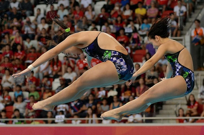 Singapore divers Fong Kay Yian (right) and Ashlee Tan Yi Xuan competing at the SEA Games on June 8.