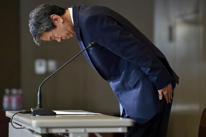 Japan's electronics giant Toshiba president Hisao Tanaka bows his head at a press conference at the company's headquarters in Tokyo.