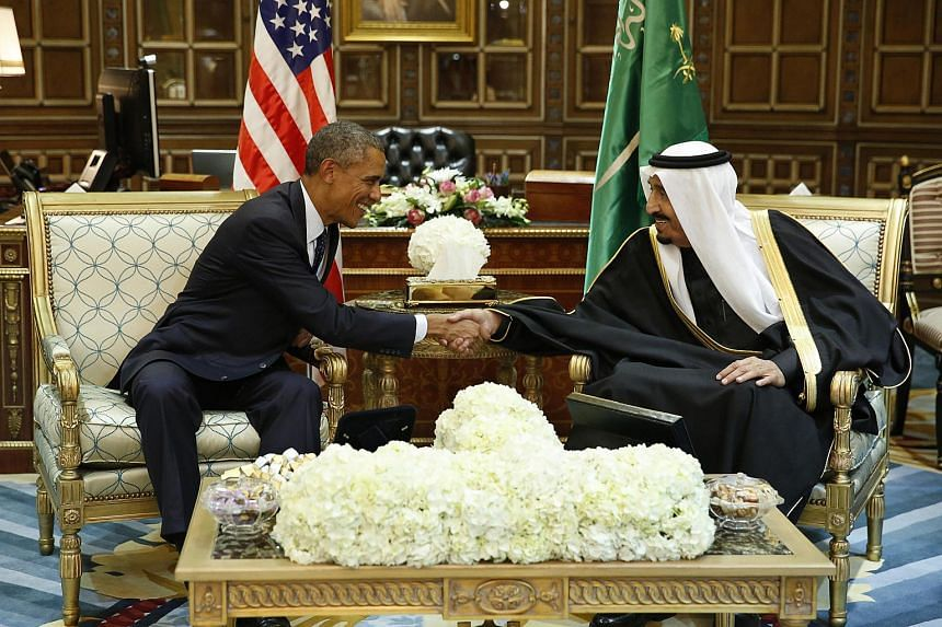 US President Barack Obama (left) shakes hands with Saudi Arabia's King Salman at the start of a bilateral meeting at Erga Palace in Riyadh.