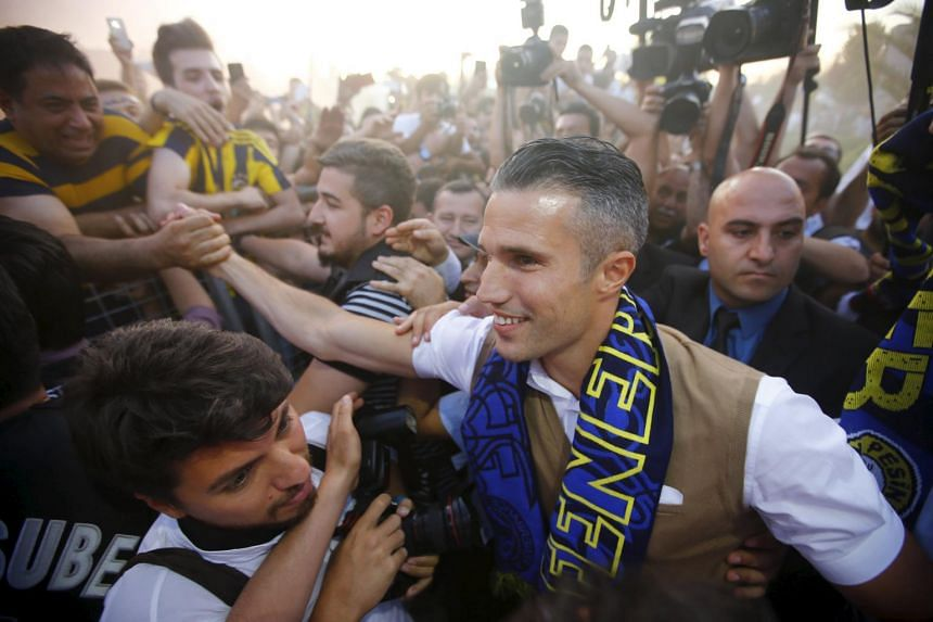 Van Persie greets supporters of Turkish soccer club Fenerbahce upon his arrival in Istanbul, Turkey.
