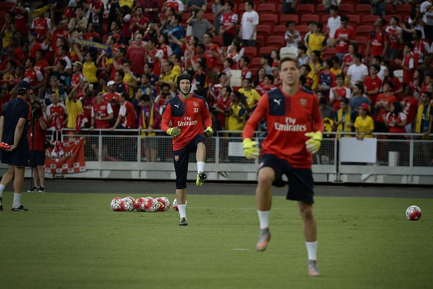 New Arsenal signing Petr Cech (left) and goalkeeper Wojciech Szczesny (right) train with the rest of team at the National Stadium during an open training session on July 14, 2015.