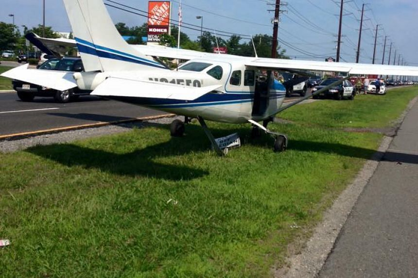 The video showed the pilot of the small-engine plane making an emergency landing on a grass patch on the expressway after its engine lost power.