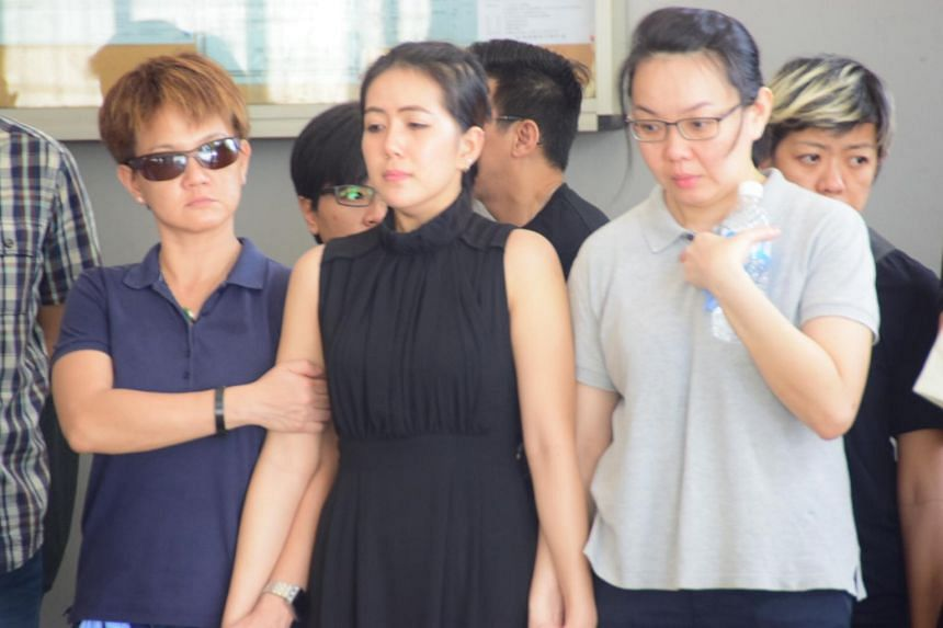 Mr Yeo's widow (in black), accompanied by his sisters, at the funeral on July 16, 2015.