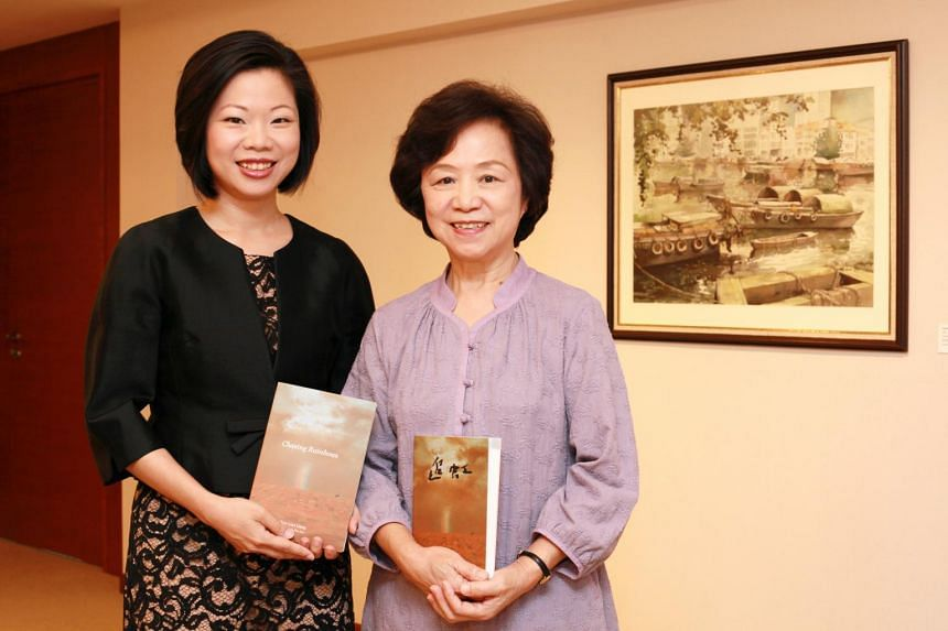 Ms Sim Ann, Minister of State for Education and Communications and Information, and her mother Madam Choo Lian Liang, holding copies of Madam Choo's book Chasing Rainbows.