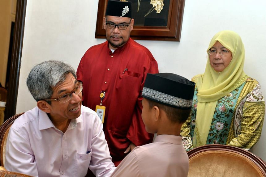 Dr Yaacob Ibrahim (left) during an iftar event on July 15, 2015.