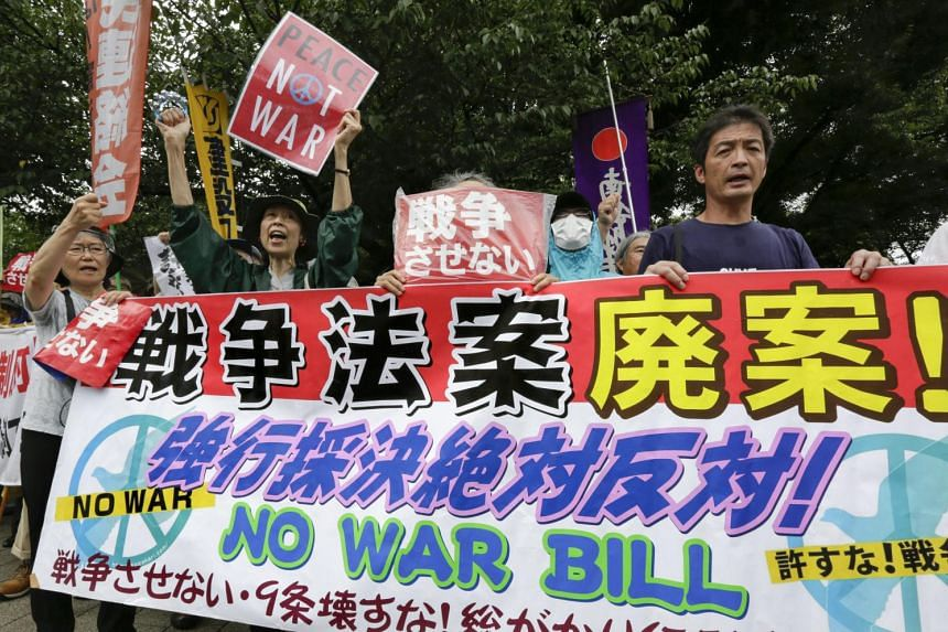 Demonstrators protest against security bills outside Japan's Parliament in Tokyo, Japan, on July 16, 2015 as the bills are forced to pass at the Lower House.
