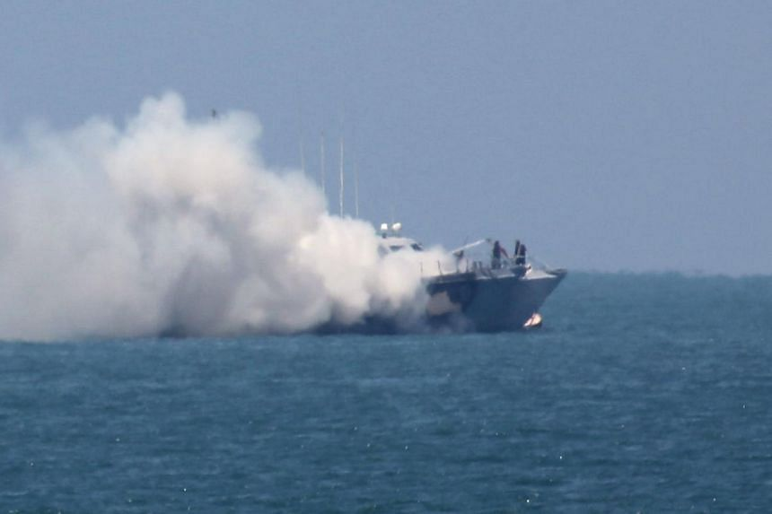Smoke billowing from an Egyptian naval vessel on the maritime border between Egypt and the Palestinian Gaza Strip, off the coast of Rafah in southern Gaza, on July 16, 2015.