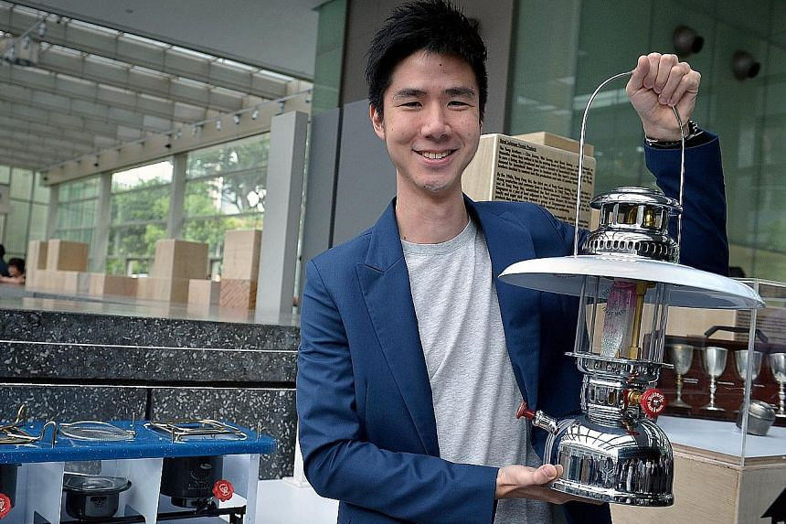 Mr Woo Ren Chai, director of Lea Hin, with one of the kerosene lamps the family-owned business makes.
