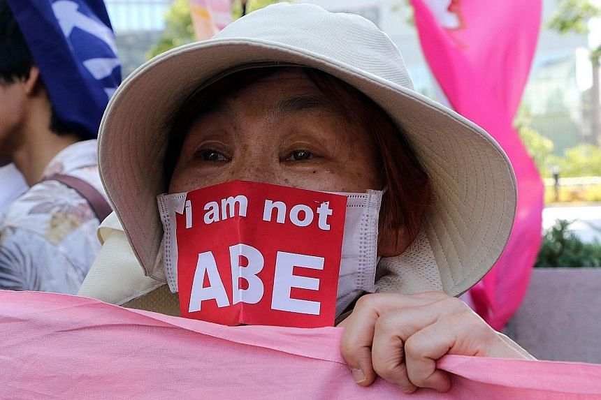 A protester outside the Parliament building in Tokyo yesterday during a rally against the security Bills. Japanese leader Shinzo Abe is determined to push the legislation to expand the role of the military through Parliament, despite most voters oppo