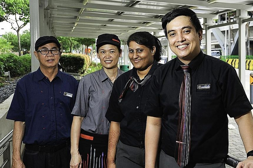 Mr Karl Alvendia Rodriguez (right) with fellow McDonald's staff (from left) Mr Hoo Hang Chai, Ms Ng Chai Eng and Ms Komala Devi Maniam. A photo of Ms Komala and her colleagues giving out drinks was posted on Twitter, where it received much praise fro