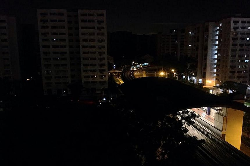 Flats in Bukit Panjang seen during Tuesday night's blackout. A total of 19 blocks in the area were affected, with the electricity supply disruption occurring at 10.08pm and power being fully restored by 11.18pm.