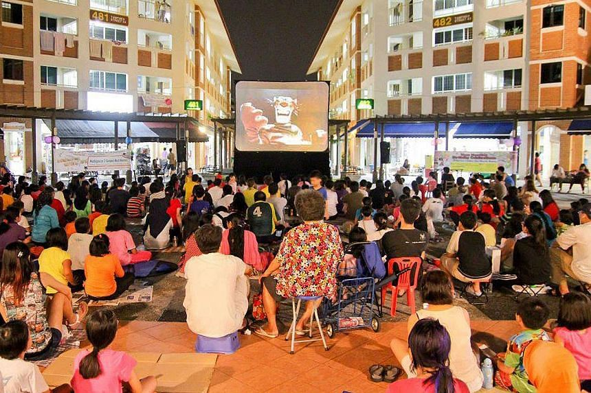 Residents of Tampines North enjoying one of their free movie screenings - under the stars - at the community courtyard beside Block 480, Tampines Avenue 9.