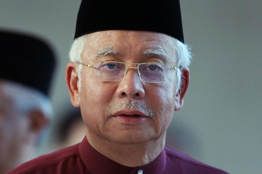 "Mr Najib Razak has dismissed reports implicating him in a graft case as ""baseless smears""."