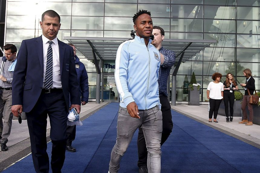 New Manchester City signing Raheem Sterling leaving the club's Etihad Stadium. At £49 million from Liverpool, he is their costliest purchase.