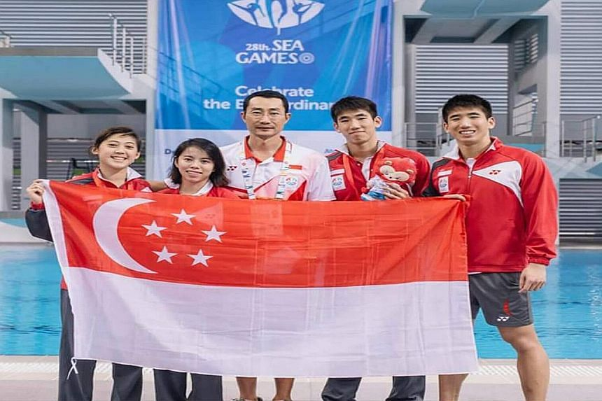 National diving coach Xu Jie with his charges (from left) Freida Lim, Myra Lee and twins Mark and Timothy Lee during last month's SEA Games in Singapore.