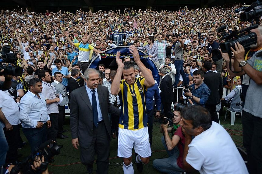 Dutch striker Robin van Persie arriving to a raucous greeting by a sea of Fenerbahce fans at his signing ceremony. The 31-year-old left Manchester United after just three seasons, following eight years at Arsenal.